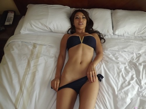 Asian beautiful girl dancing and stripping
