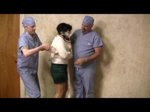 [Straitjacketed.2] Dr Gigi Forced Into A Straitjacket-Part 1 (2012/98.27 MB/Array)
